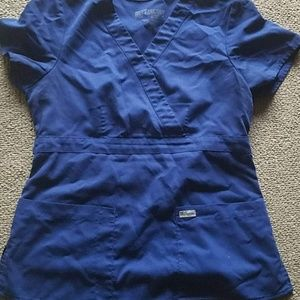 2 blue scrub tops